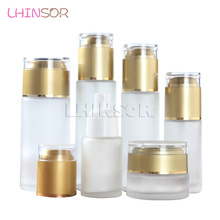 купить 10pcs/lot  Frosted Glass Lotion Bottle  Spray Bottles  Cream Jar  Press Pump with Acrylic Lid Cosmetic Set Packaging Containers по цене 976.97 рублей