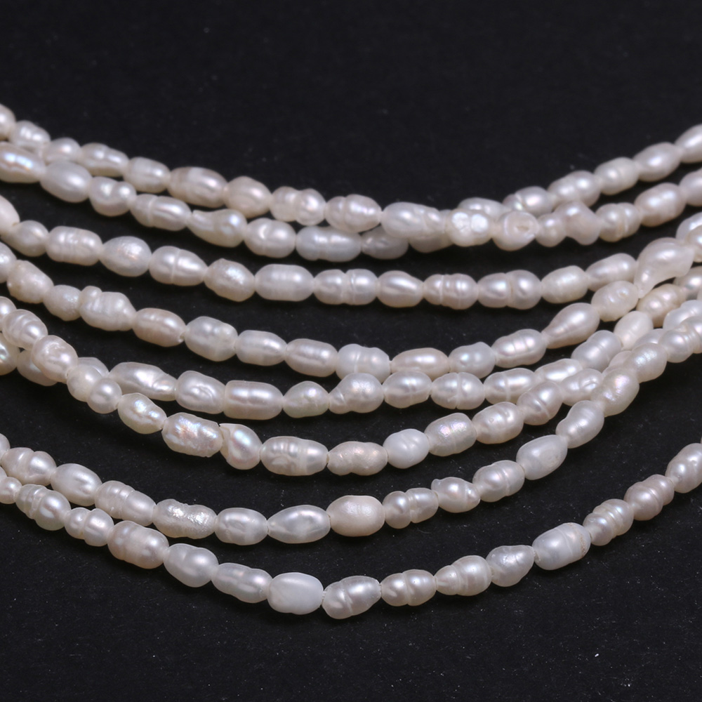 Top drilled Dancing Rice Freshwater Pearl apple green 5X8mm AAA Gem quality briolette tear drop pearl beads 15 full strand 85 pc #DR3136