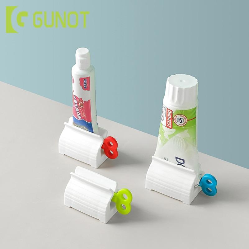 GUNOT Toothpaste Squeezer Toothpaste Dispenser Plastic Cream Tube Squeezing Dispenser Rolling Tube Squeezer Bathroom Accessories
