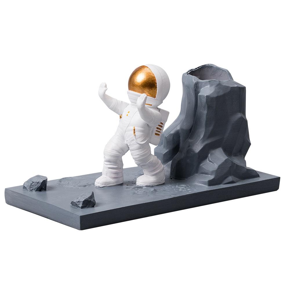 Купить с кэшбэком Nordic Resin Astronaut Figurines Model Home Decoration Multi-functional Pen Container Modern Office Desk Decorative Accessories