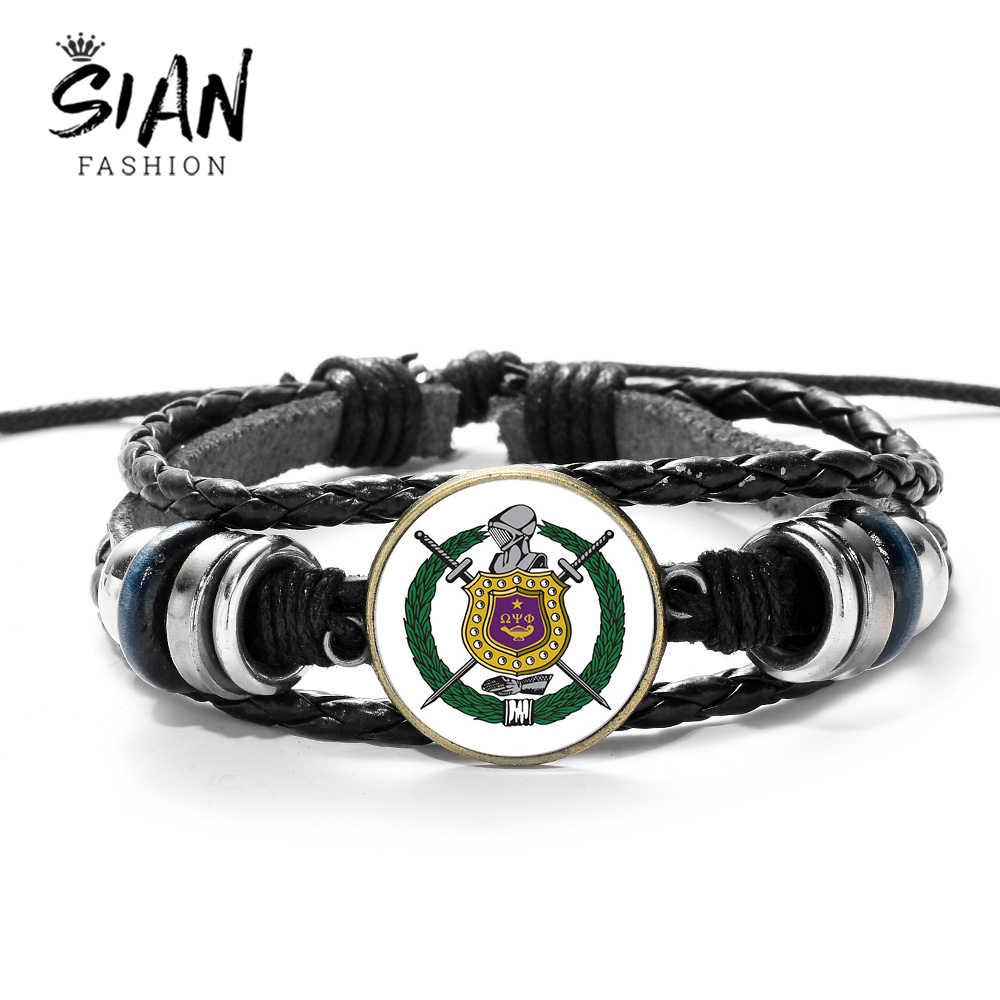 SIAN ภาษากรีกตัวอักษร Omegaa Psi Phi สร้อยข้อมือพี่น้อง Brotherhood รูปแบบสัญลักษณ์แก้วรอบอัญมณี Punk สร้อยข้อมือหนังสำหรับชาย