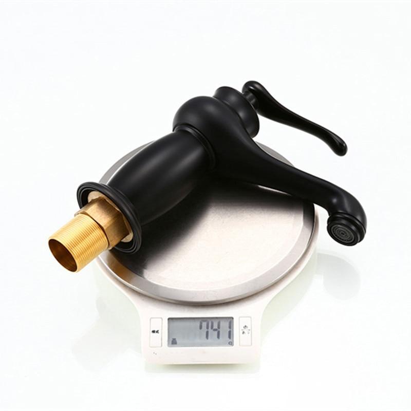 Купить с кэшбэком XUNSHINI Vintage Basin Faucet Bathroom Sink Faucet Single Handle Black Brass Deck Wash Mixer Tap Bath Crane