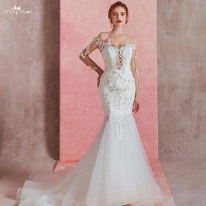 Image 1 - RSW1581 Sexy Sheer O neck z długim rękawem suknia ślubna o kroju syreny 2019 zobacz przez Illusion suknia ślubna wiązana z tyłu z koronki aplikacja