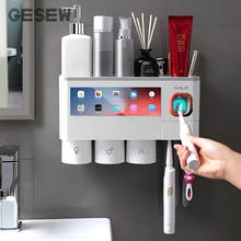 GESEW adsorpcja magnetyczna odwrócony uchwyt na szczoteczki do zębów automatyczna pasta do zębów dozownik do wyciskania stojak do przechowywania akcesoria łazienkowe
