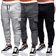 Dorywczo sportowe spodnie męskie biegaczy Fitness spodnie sportowe nowa nadrukowana moda Muscle Man Fit spodnie treningowe męskie plisowane spodnie tanie tanio DKNG BRO Ołówek spodnie CN (pochodzenie) Plisowana COTTON Kieszenie skinny 29 - 36 Pełnej długości M L XL XXL XXXL