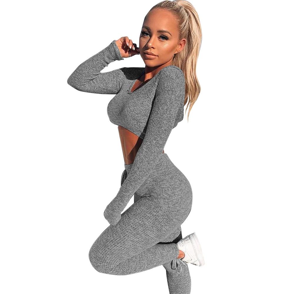 Сексуальный трикотажный спортивный костюм с v образным вырезом