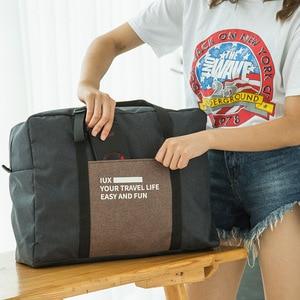 Airplane bag new waterproof casual folding travel bag boarding bag Portable type finishing bag luggage bag duffle storage bag
