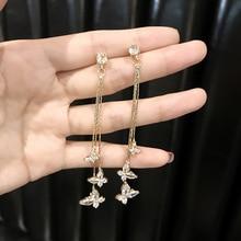 S925 Silver Needle luxury Superflash Butterfly zircon earring woman 2019 New temperament Korean long ear nail pendant girl