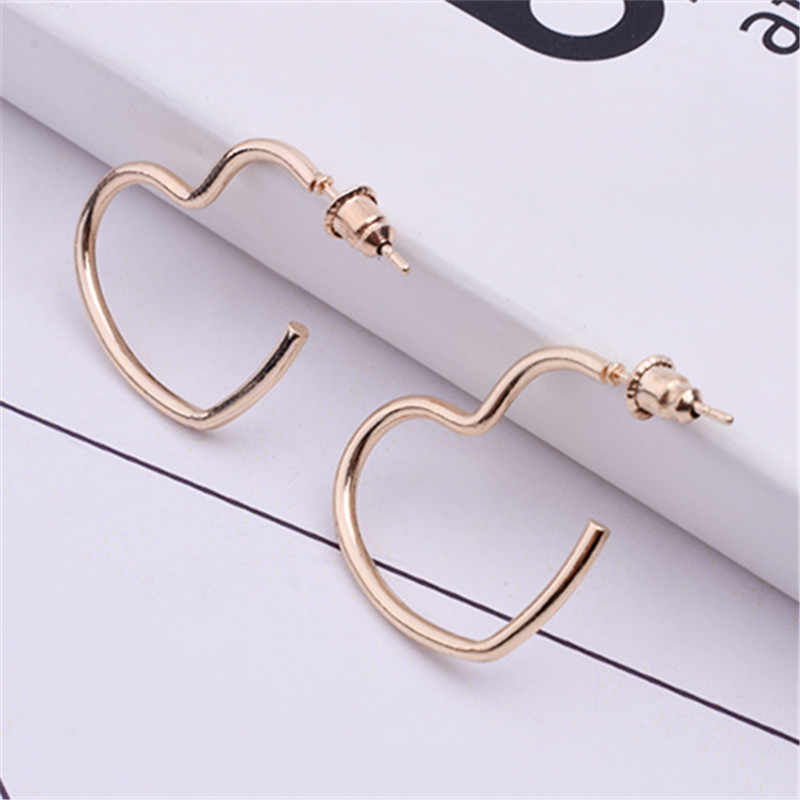 New Fashion Hollow Love Heart Earring Metal Plating Ornaments Simple Dangle Earrings For Women Copper Brincos Jewelry