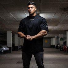 Nowy Hip-styl hiphopowy Shortsleeved Fitness sportowy T-shirt Plus Size męska 2020 lato do biegania na co dzień bawełna ubrania do ćwiczeń siłownia topy