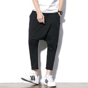 Image 1 - ผู้ชายกางเกง Hip Hop Streetwear ลำลอง Harem กางเกงผู้ชายสีดำสีเทาผ้าฝ้าย Sweatpants Solid Techwear Baggy กางเกงชาย