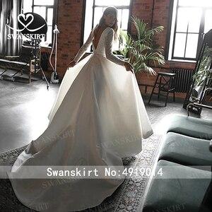 Image 5 - Prachtige Satijn Trouwjurk Swanskirt HZ32 Eenvoudige V hals Lange Mouw A lijn Prinses Bruidsjurk Aangepaste Vestido De Novia