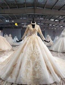 Image 2 - Ivoor Lange Mouwen Trouwjurken Met Gouden Kant Voor Vrouwen 2020 Prinses Puffy V hals Corset Real Foto Vintage Bridal jassen