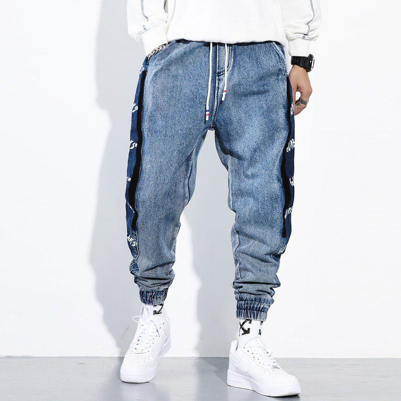 Fashion Streetwear Men Jeans Loose Fit Blue Color Cargo Pants Side Stripe Printed Designer Harem Jeans Hip Hop Jeans Men Joggers