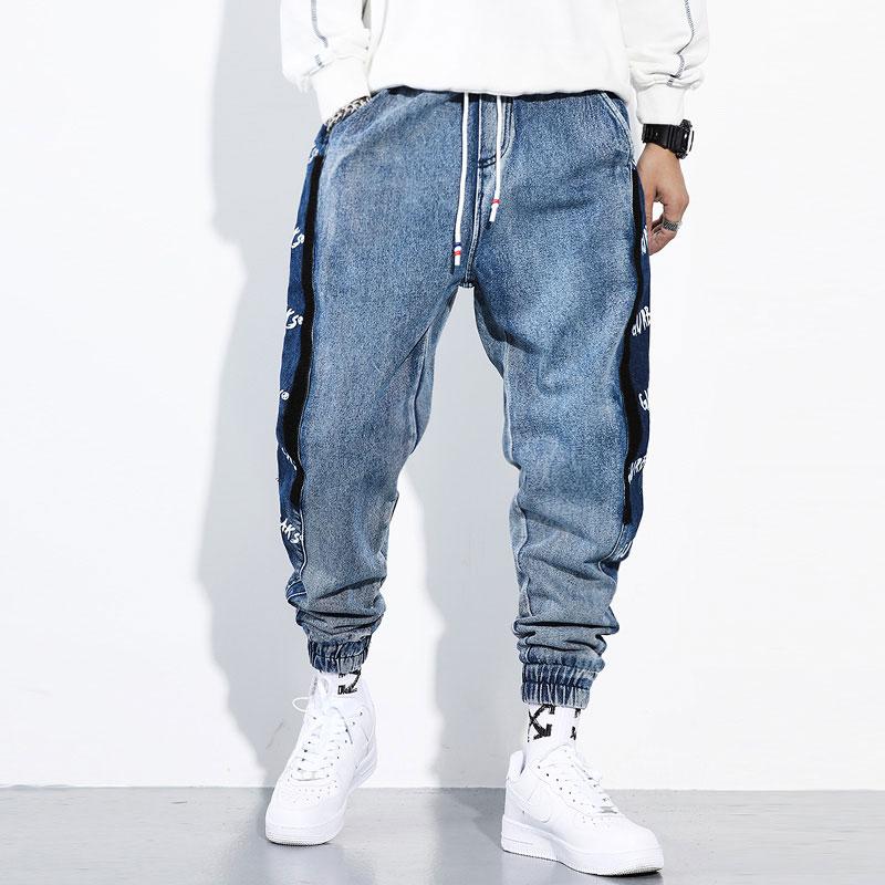 Fashion Streetwear Men Jeans Loose Fit Blue Color Cargo Pants Side Stripe Printed Designer Harem Jeans Hip Hop Jeans Men Joggers