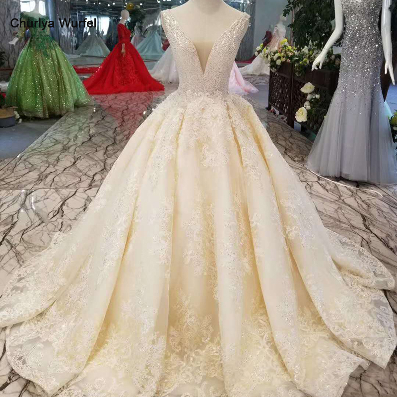 LSS1011 Sexy Sleeveless Wedding Dresses Floor Length Appliques V-back Shiny Beauty Wedding Gowns Free Shipping High Quality