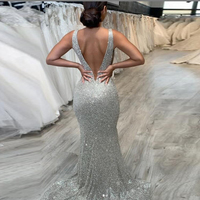 Bling Silver Mermaid Prom Gowns Long Backless See Through abiye robe de soiree Floor Length Sequins Evening Party Dress Slit