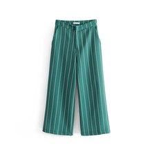 wysokim nogawki stanem spodnie