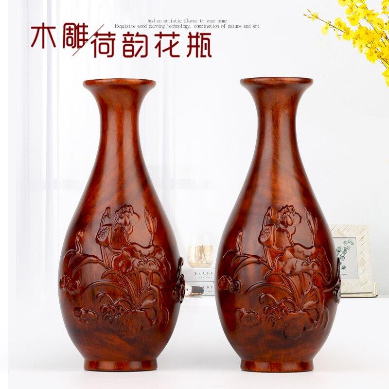Annatto artisanat de sculpture sur bois vase feng shui vit en acte le rôle de l'ornement de bois pour placer un article casse-noisette