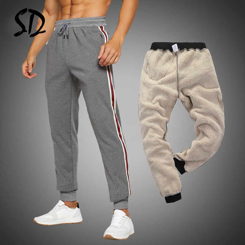 ฤดูหนาวผู้ชายกางเกงขาสั้นเข่าความยาวฟิตเนส Gyms กางเกงแฟชั่นหลวมผู้ชาย Jogger Sportwear ยืดหยุ่นบางกางเกงขาสั้นสินค้ากางเกงขาสั้นผู้ชาย