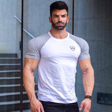 2017Brand muscle guys Mens gyms T shirt bodybuilding and fitness men cotton singlets tops Plus size T-Shirt Shorts Sleeve Tshirt
