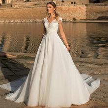 Элегантное бальное платье свадебное с рукавом крылышком и v