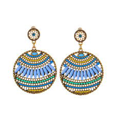 New bohemian earrings Women's European and American fashion hollowed-out earrings all-match temperament accessories new hand woven u shaped earrings exaggerate bohemian hollowed out tassels and national wind earrings