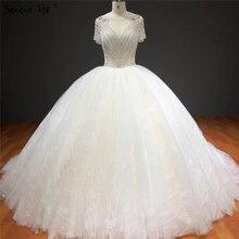 לבן קצר שרוולים Sparkle גבוהה סוף חתונת שמלות סקסיות ואגלי יהלומי יוקרה כלה שמלות HA2275 תפור לפי מידה