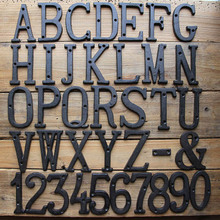 House Numbers, Cast Iron Metal Home Address Number, Heavy Duty & Sturdy, Unique Hammered Look,figures on the door