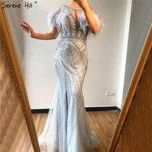 فستان رسمي من Dubai حورية البحر بفتحة رقبة على شكل حرف v مطرز بالماس 2020 بالريش الفضي والغزل فساتين سهرة مثيرة Serene Hill BLA70355