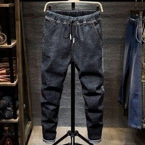 Image 2 - Large size jeans black mens  man plus size harem pants autumn elastic stretch Slim feet trousers 7XL 6XL 5XL