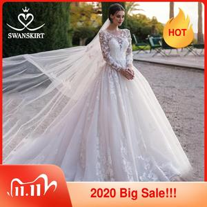 Image 1 - Swanskirt רומנטי 3D אפליקציות חתונת שמלת 2020 סקופ צוואר ארוך שרוול כדור שמלת אשליה הכלה שמלת Vestido דה Noiva K186