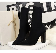 Stylish simple wood grain heel thick heel high heel pointy thin ankle boots(China)
