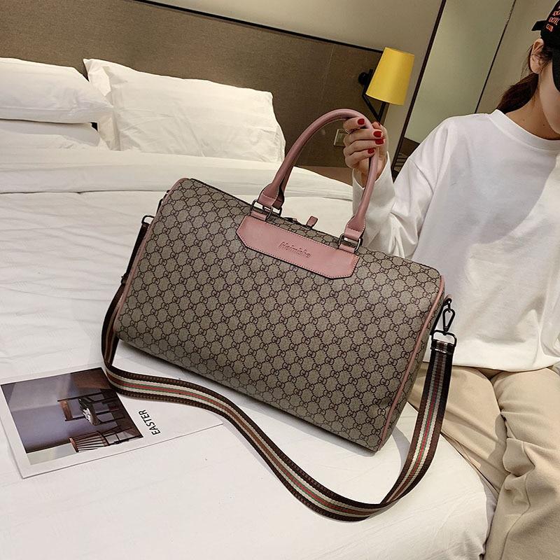 Europäischen Und Amerikanischen Stil Mode Neue Reisetasche frauen Kurze Reisetasche Große Kapazität Seesack Hand Tasche männer Wasserdicht