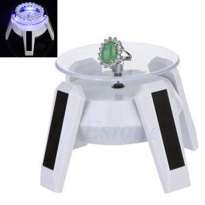Obrotowy zasilany energią słoneczną telefon w zegarku stojak wystawowy na biżuterię + LED Light 634D