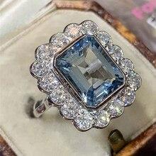 Huitan nova moda feminino festa de casamento anéis de dedo luz brilhante azul cristal cz pedra graciosa anel de casamento nupcial jóias em massa