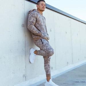 Image 4 - Sports suits Men Set Brand Fitness Suits autumn Men Set Long Sleeve Camouflage Hoodies+Pants Gyms Running Sportswear Suit
