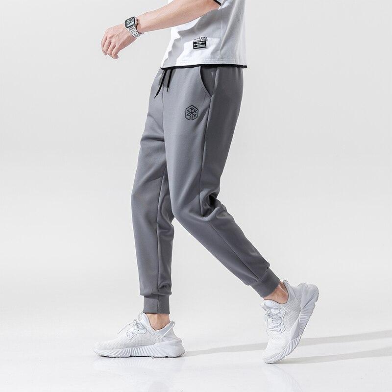Men's High Quality Brand Men Pants Fitness Casual Elastic Pants Bodybuilding Clothing Casual Sweatpants Joggers Pants