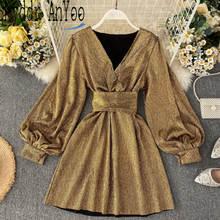 Женское блестящее платье с длинными рукавами фонариками золотистое