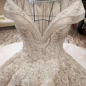 Image 5 - LS59840 see through scoop neck 2018 new design satin cap sleeve big heavy skirt super long train corset back wedding dress