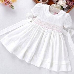 Image 1 - Letnie dziewczynek sukienki białe smocked handmade bawełna w stylu vintage ślub odzież dla dzieci księżniczka Party butiki ubrania dla dzieci