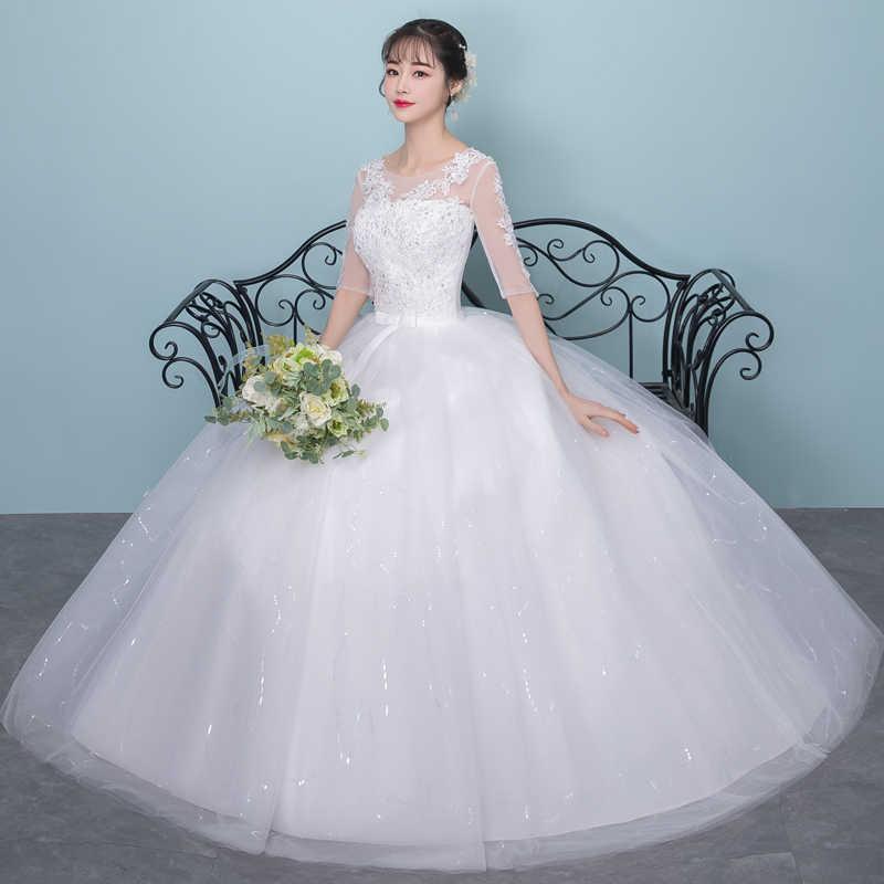 שלושה רבעון תחרה שרוול סקסי חתונת שמלת Lamya פתוח חזרה קשת קשר Sashes טול כלה כדור שמלה