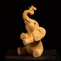 Śliczne szczęście Feng Shui słoń statua zwierząt rzeźba z drewna bukszpanu kreatywne akcesoria do domu rękodzieło dekoracyjne drewniane ozdoby słonia w Posągi i rzeźby od Dom i ogród na