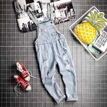 Mens Hip Hop Loose Denim Bib Overalls Male Streetwear Ripped Jeans Jumpsuit Men Casual Suspender Working Cargo Denim Pants Blue rolling hem ripped design denim suspender jumpsuit