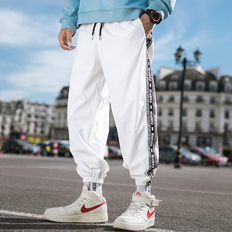 Brand Men's Sweatpants New Polyester Hip Hop Harem Pants Jogging Wide Leg Pants Men's Spring Autumn Fashion Print Cross Pants