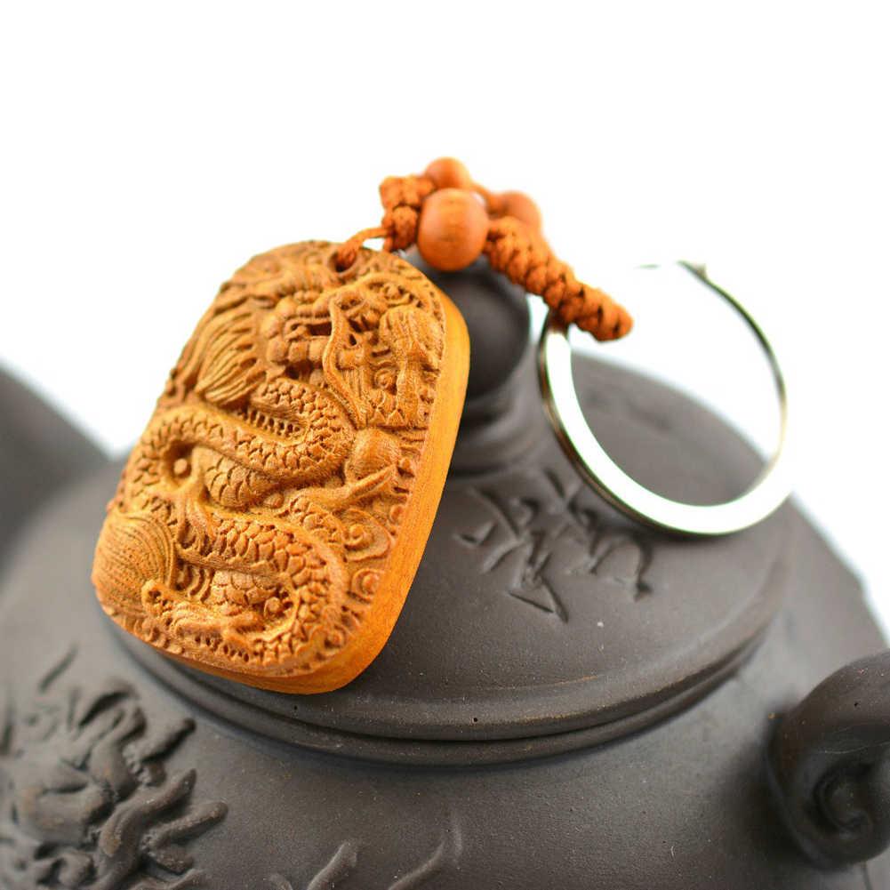 Brzoskwinia rzeźbione w drewnie chiński smok szczęśliwa statua wisiorek brelok z klamrą brelok chiński posąg smoka rzeźbione powodzenia i happys