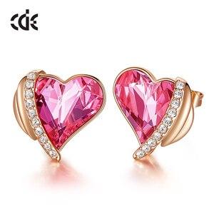 Image 1 - CDE Frauen Gold Ohrringe Schmuck Verziert mit Kristallen von Swarovski Rosa Engel Flügel Herz Stud Ohrringe Feine Schmuck Geschenke