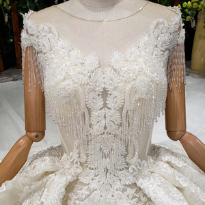 Image 5 - HTL990 lace wedding dress in Wedding Dresses o neck short sleeved bead wedding gowns with tail illusion back vestidos de noivas