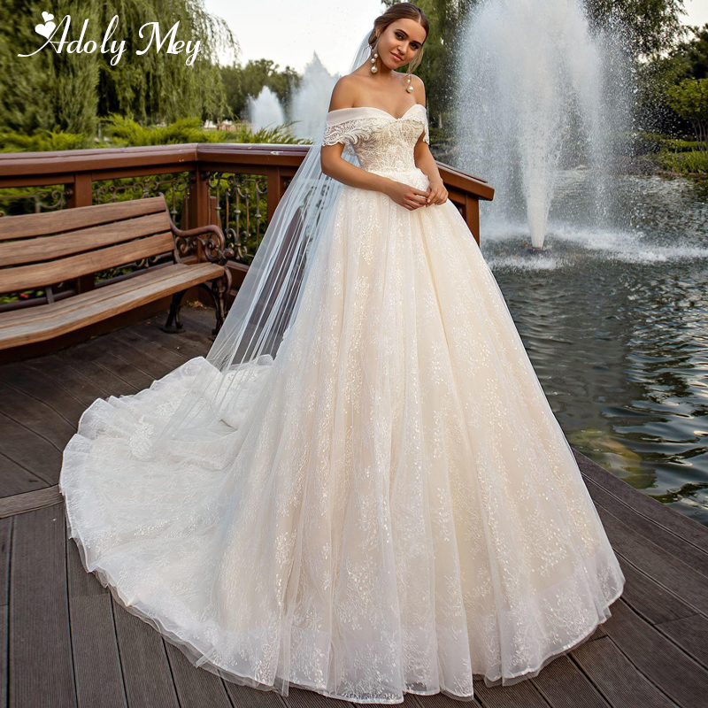 Adoly Mey Romantic Boat Neck Button Lace A-Line Wedding Dresses 2020 Luxury Beaded Appliques Chapel Train Princess Wedding Gown