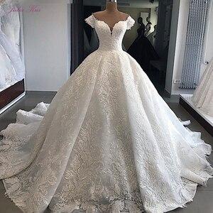 Image 1 - ג וליה Kui מתוקה מחשוף יוקרה כדור שמלת חתונת שמלה עם עדין אפליקציות מכתף